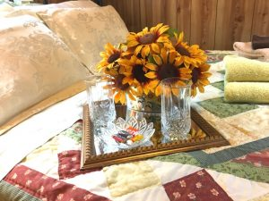 Sunnybrook queen bed with tray and sunflowers