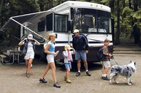 camper with kids and dog