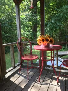 Sunnybrook deck with red set and sunflowers